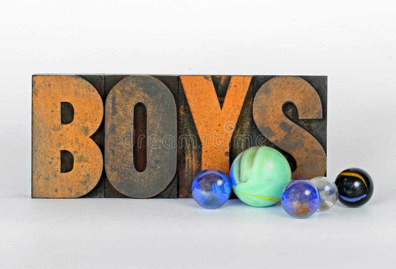 Boys. Vintage Wood Type With Colorful Marbles stock images