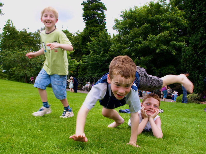 Boys. A photograph of three boys playing in summer royalty free stock image