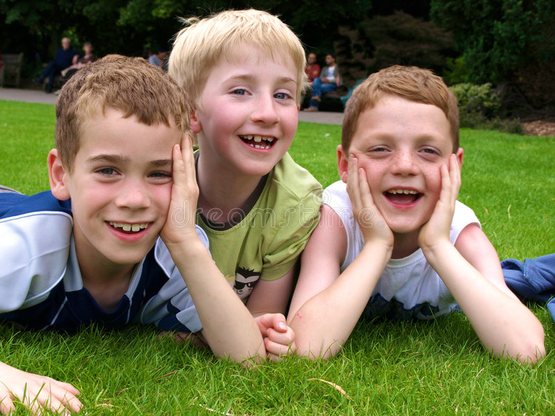 Boys. A photograph of three boys playing in summer royalty free stock photos