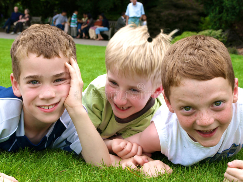 Boys. A photograph of three boys playing in summer stock image
