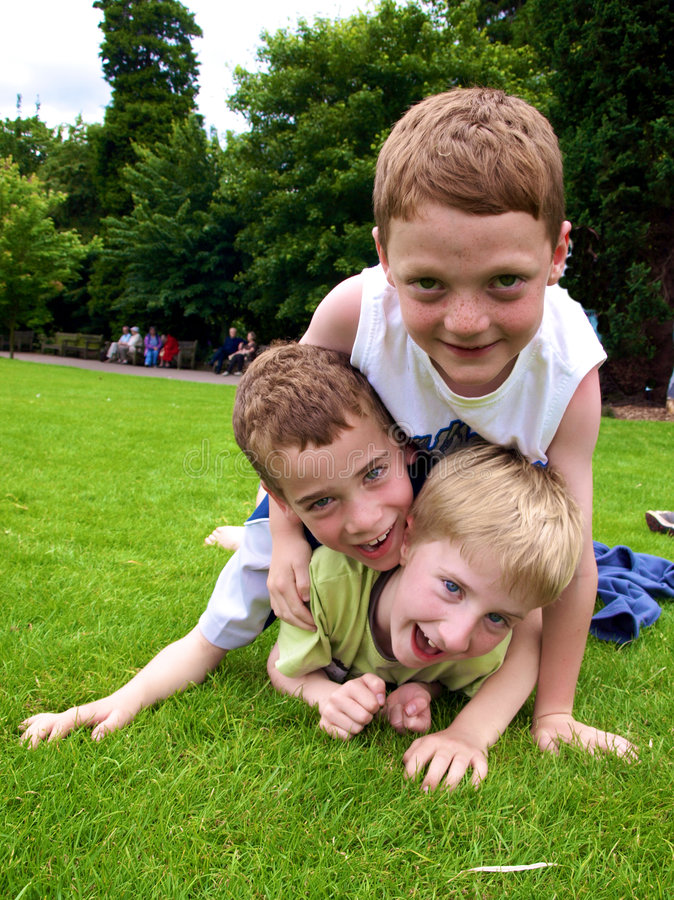 Boys. A photograph of three boys playing in summer royalty free stock photography