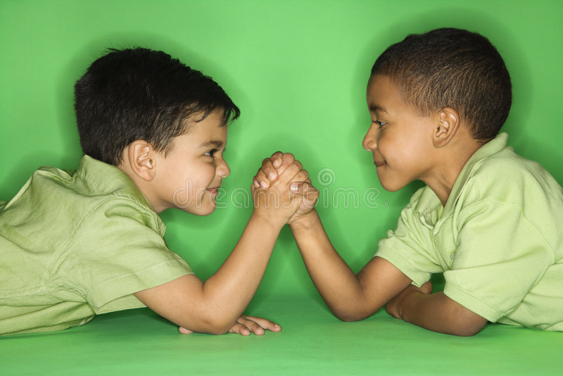 Boys arm wrestling. royalty free stock image