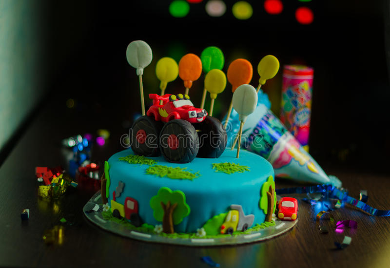 Boys birthday cake with red car royalty free stock image