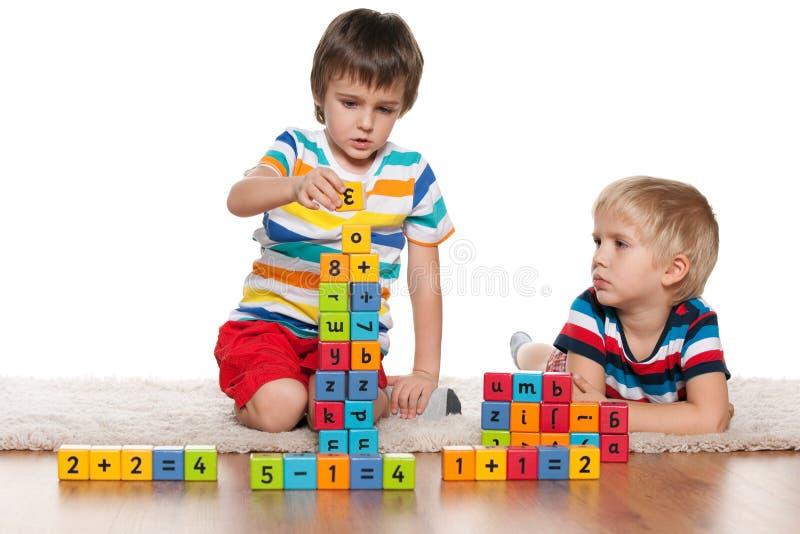 Boys with blocks on the floor stock photo