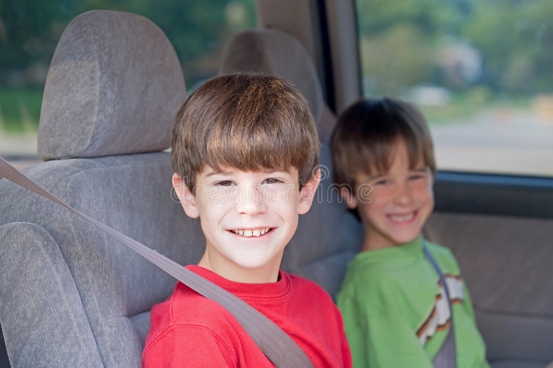 Boys in Car. Boys Buckled up in Automobile