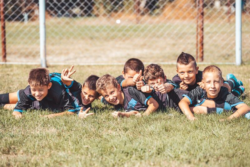Boys celebrating after football match royalty free stock photography
