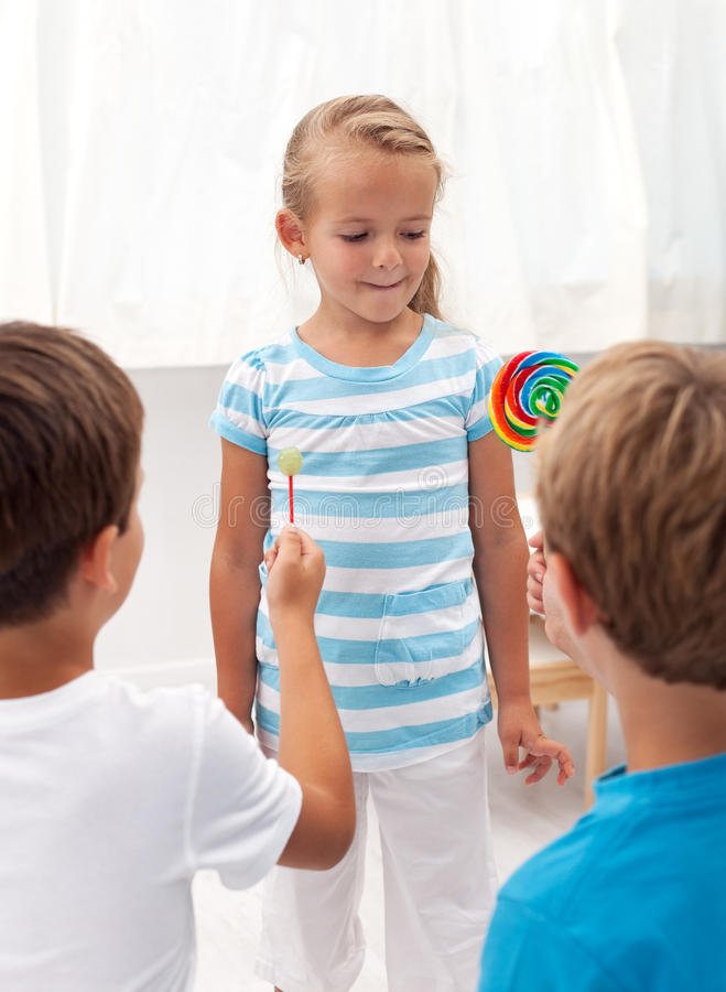 Boys Courting A Little Girl Royalty Free Stock Photography