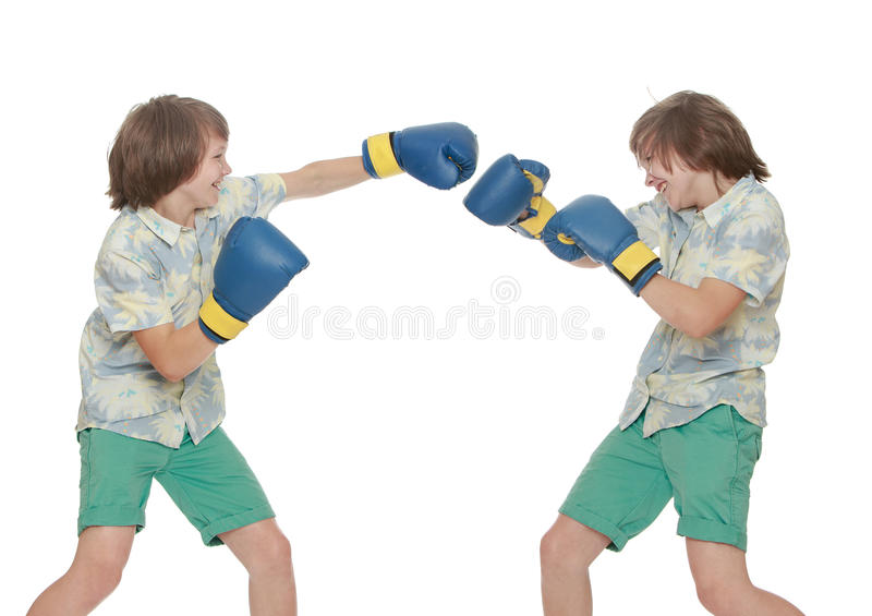 Boys do Boxing. A collage of two photos where there is one person. Two identical young man in gloves-Boxing among themselves. Close-up- on white background stock photos