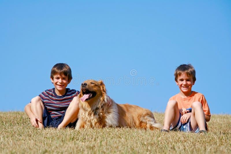 Boys and Dog stock photos