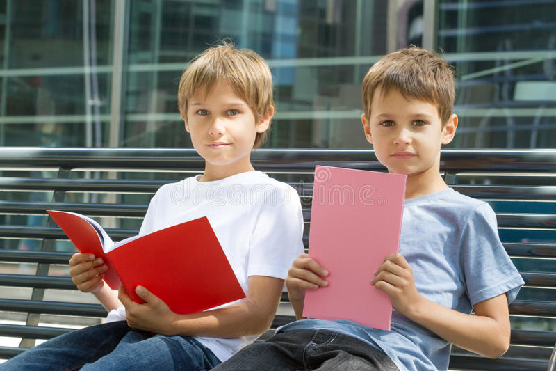 Boys doing homework outdoors. Back to school concept. royalty free stock image