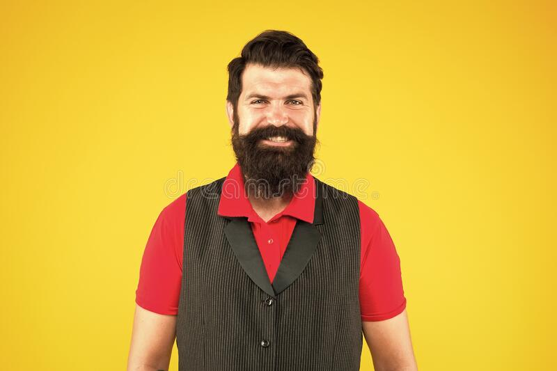 Boys dont cry. Happy hipster. Hipster smile yellow background. Brutal hipster with thick beard hair. Bearded man in. Casual hipster style. Barbershop. Barbers royalty free stock image