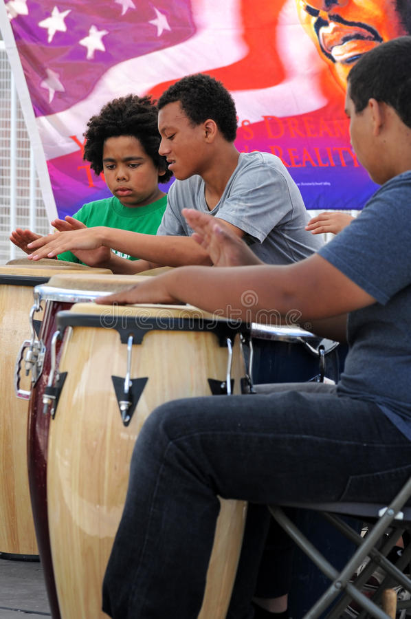 Boys drumming at Los Angeles festival stock photos
