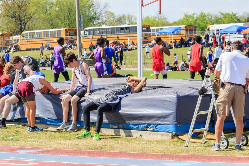 Boys Exhausted After 1600 Meter Heat at Invitational. Boys succumb to exhaustion just after completing a 1600 meter heat at the Montgomery, Alabama High School royalty free stock images