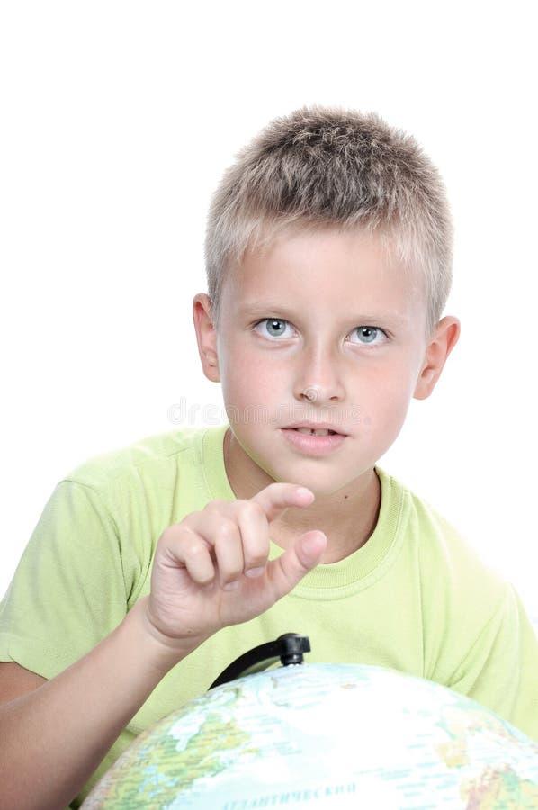 Boys finger pointing on world globe royalty free stock photography