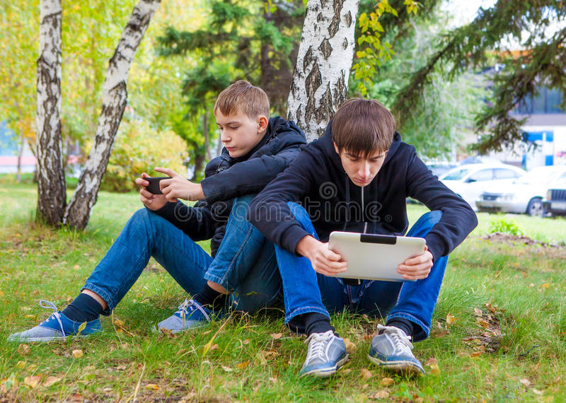 Boys with Gadgets royalty free stock image