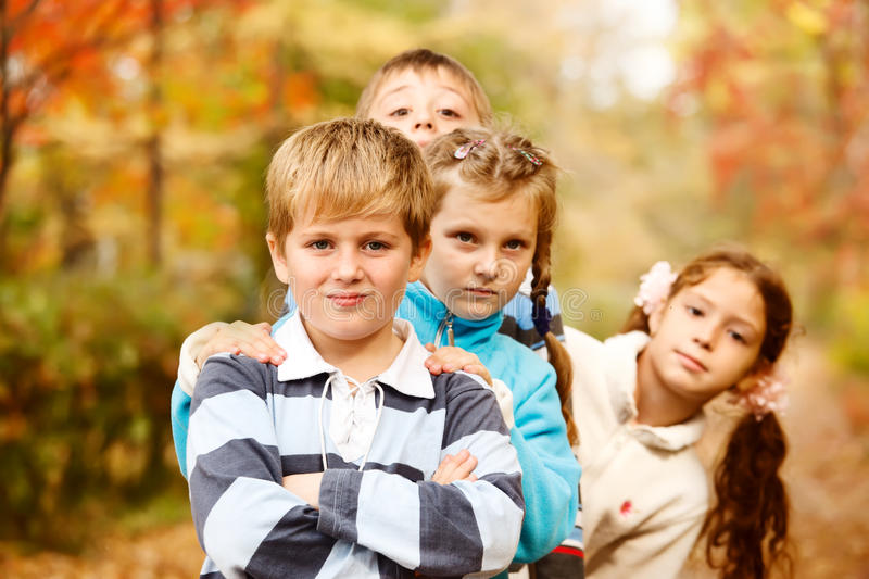Boys and girls in autumn stock photo