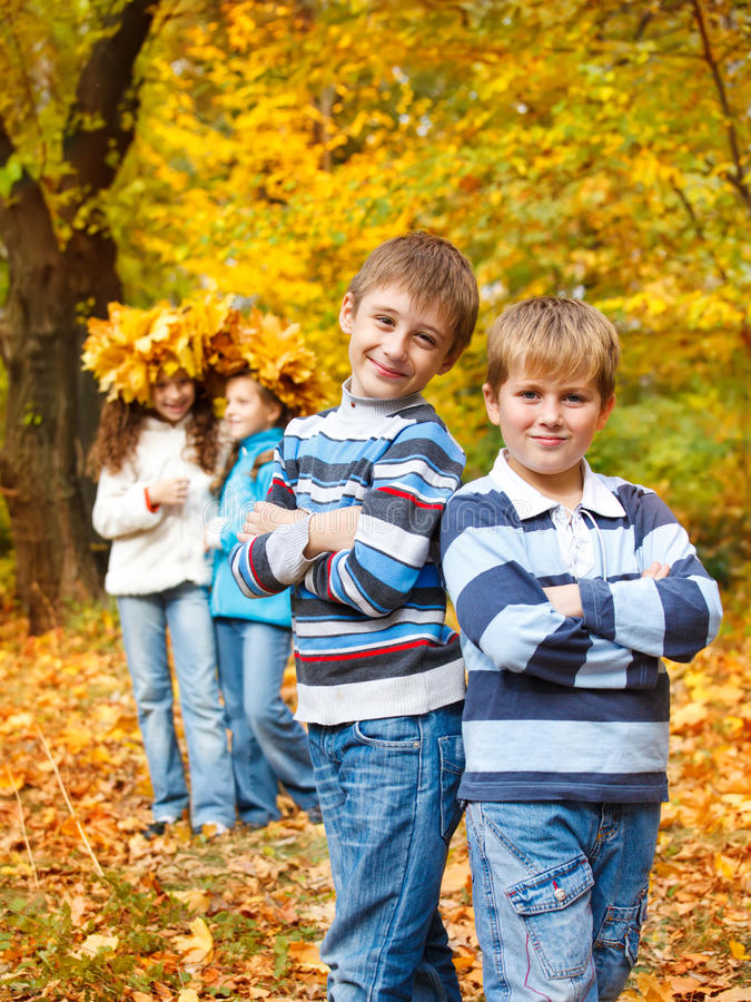 Boys and girls in fall royalty free stock photo
