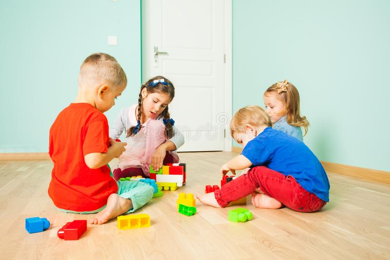 Big family together get a floor time, kids and toys stock photography