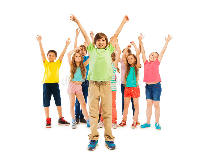 Boys and girls stand together with hands raised up royalty free stock images
