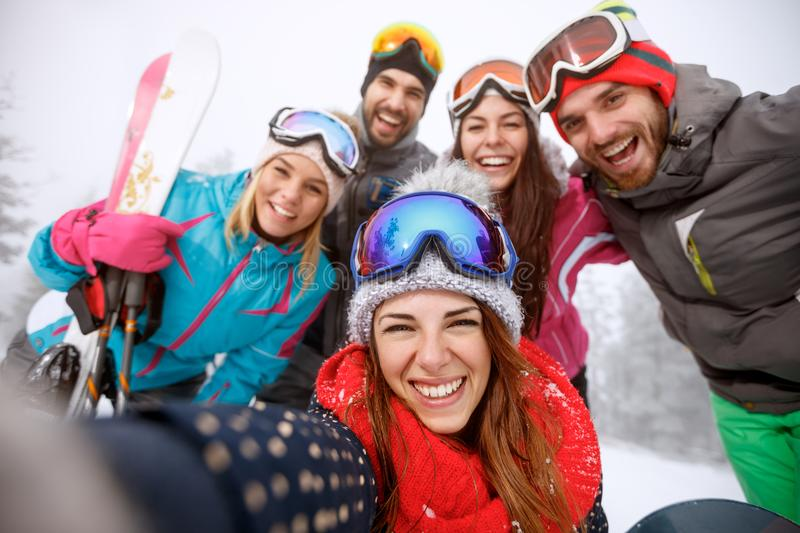Boys and girls together on skiing royalty free stock image