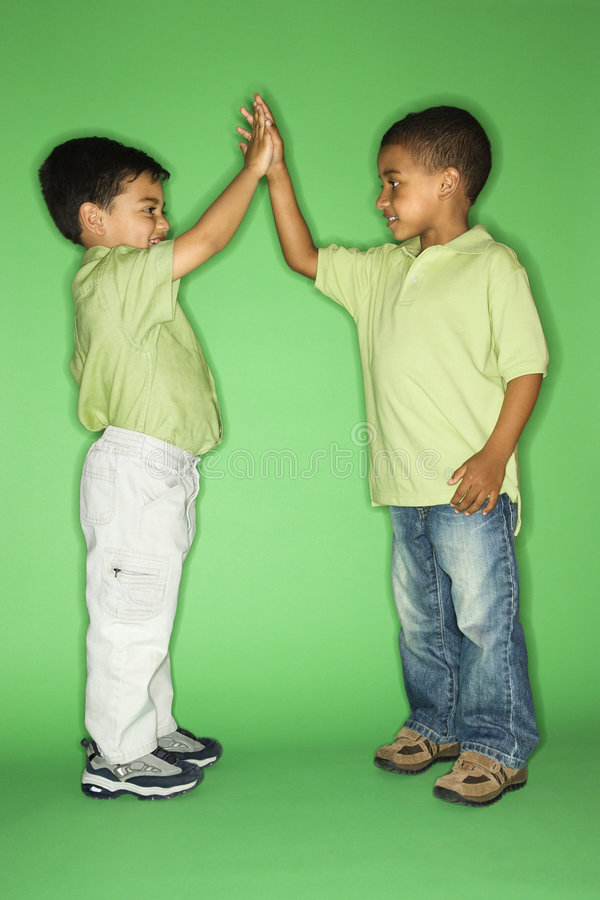Boys giving high fives.
