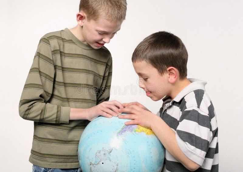 Boys and globe stock photos
