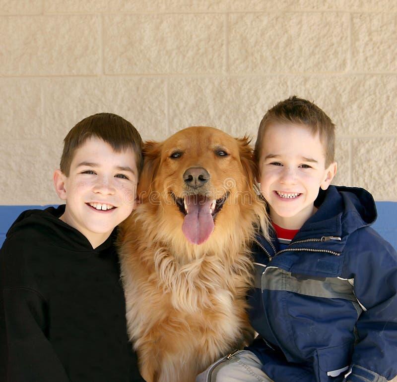 Boys and Golden Retriever royalty free stock photos