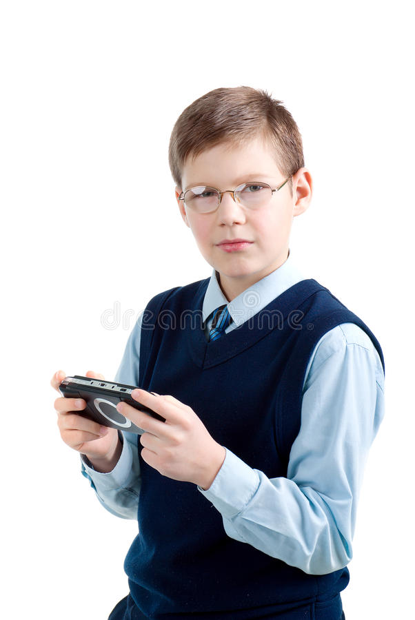 Boys hand playing portable video game i royalty free stock photos