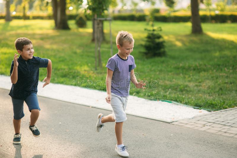 Boys have activity. Children run around and jumt up in the air.  royalty free stock photography