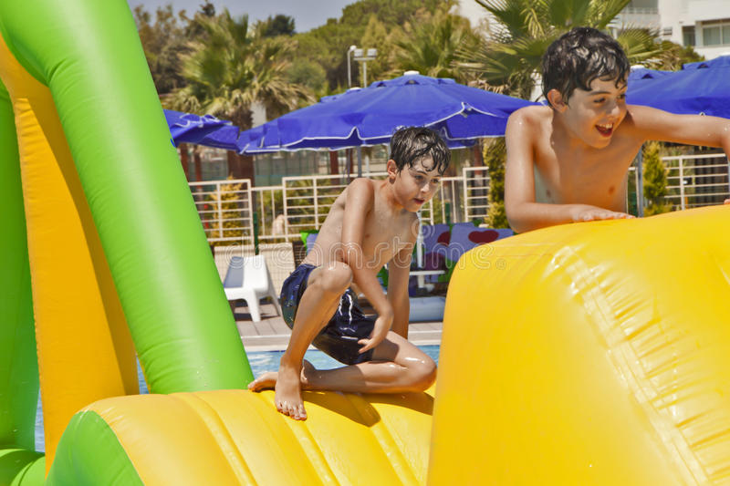Download The Boys  Are Have Fun In The Aqua Park Stock Photo - Image: 39323070
