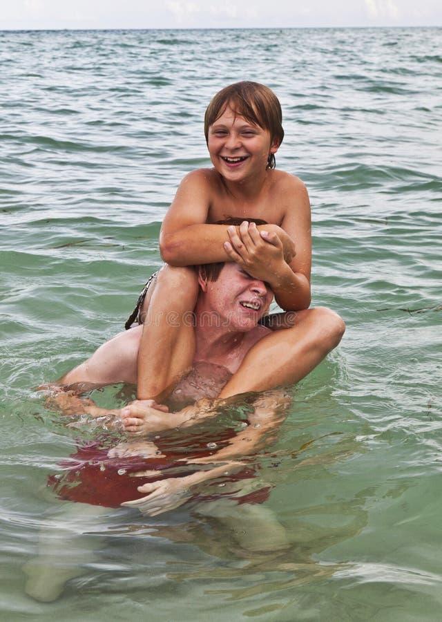 Download Boys Having Fun In The Beautiful Clear Sea Stock Image - Image: 17001421