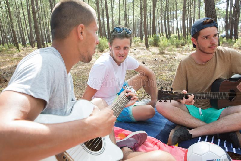 Boys jamming with their guitar. Guitar royalty free stock photography