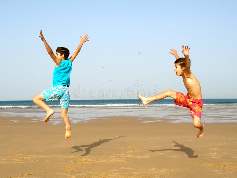 Boys jumping royalty free stock images