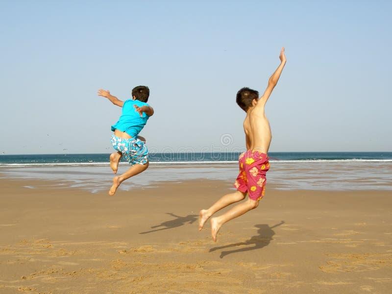 Boys jumping royalty free stock photography