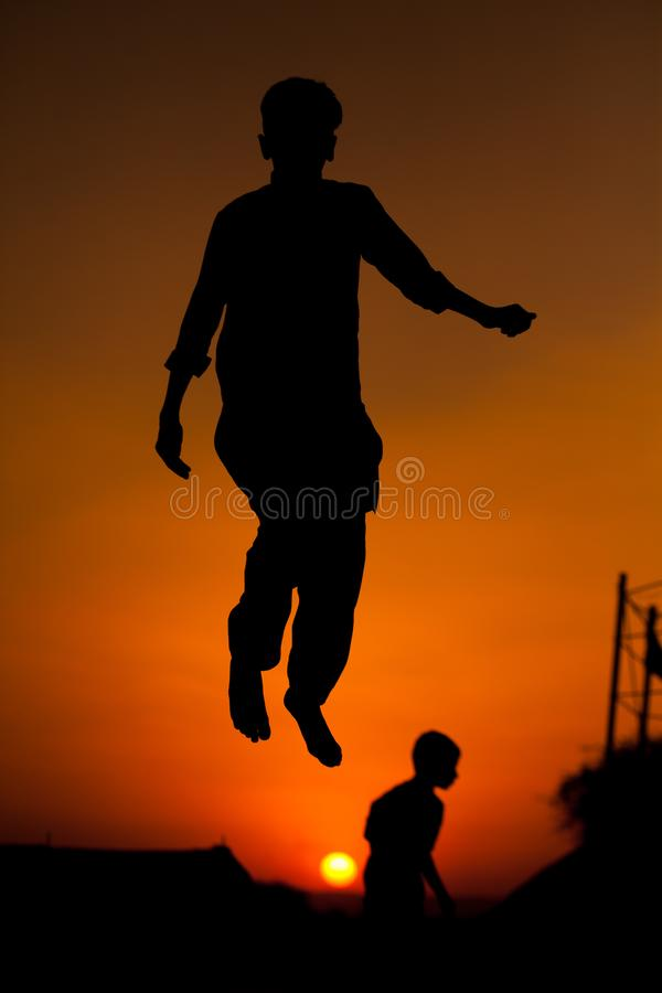Boys jumping on a trampoline stock image