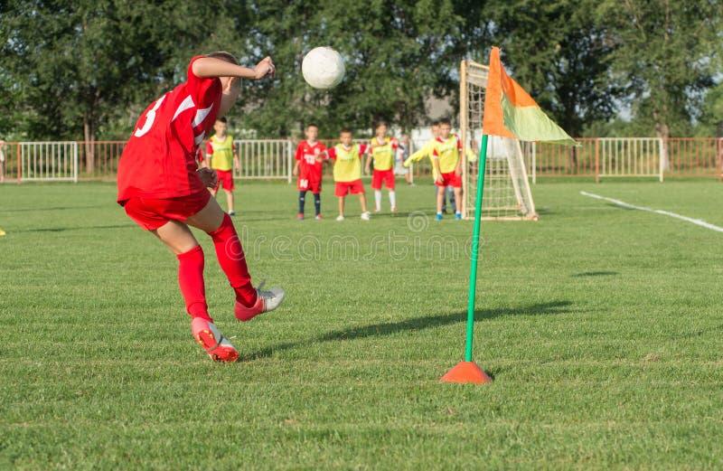 Boys kicking football stock images