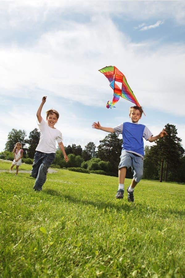 Boys with kite stock photo