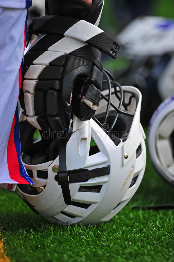 Boys lacrosse helmet at players side. royalty free stock photos