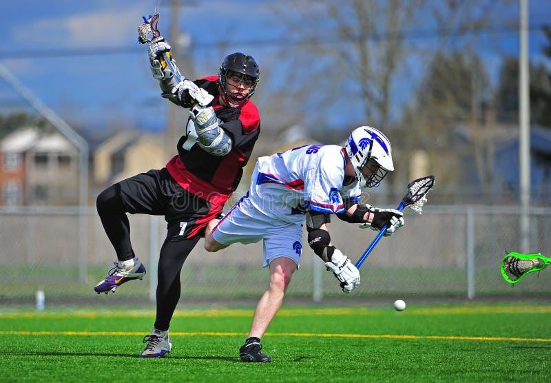 Boys Lacrosse push royalty free stock photography