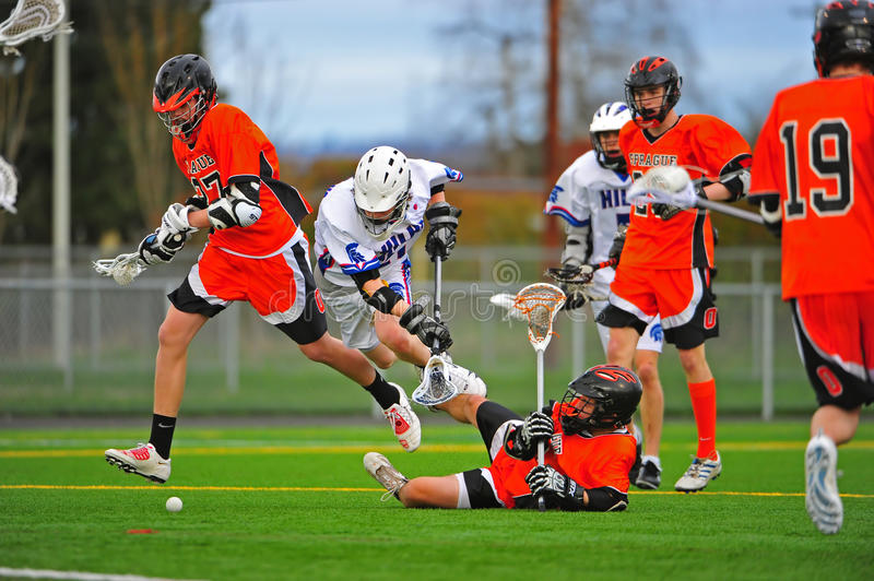 Boys Lacrosse tumbling down royalty free stock photography