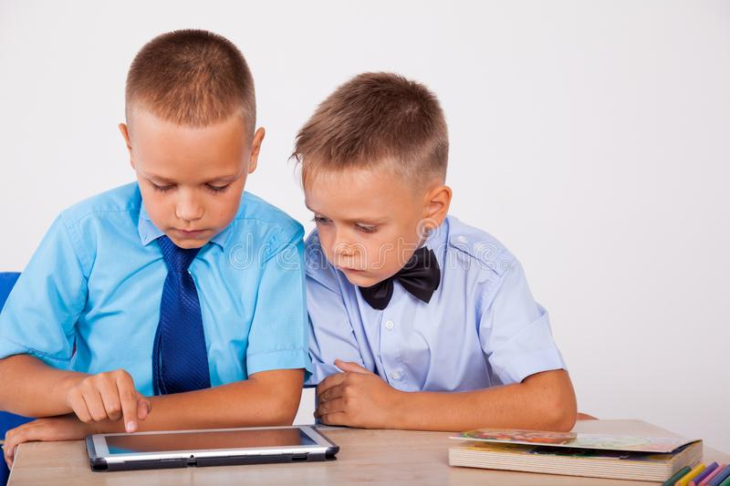 Boys learn lessons Internet Tablet royalty free stock image