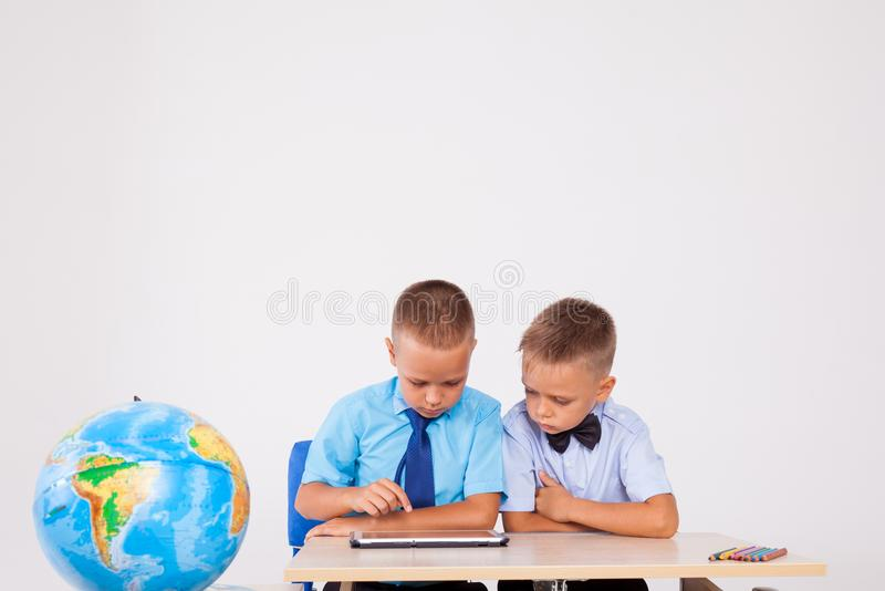 Boys learn lessons Internet Tablet royalty free stock images