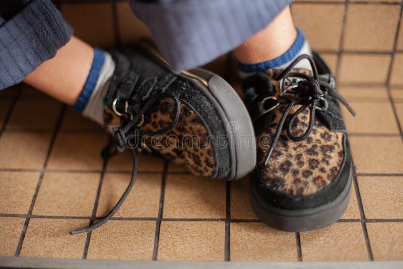 Boys Leopard print shoes. Detail close up of boys Leopard print shoes royalty free stock image