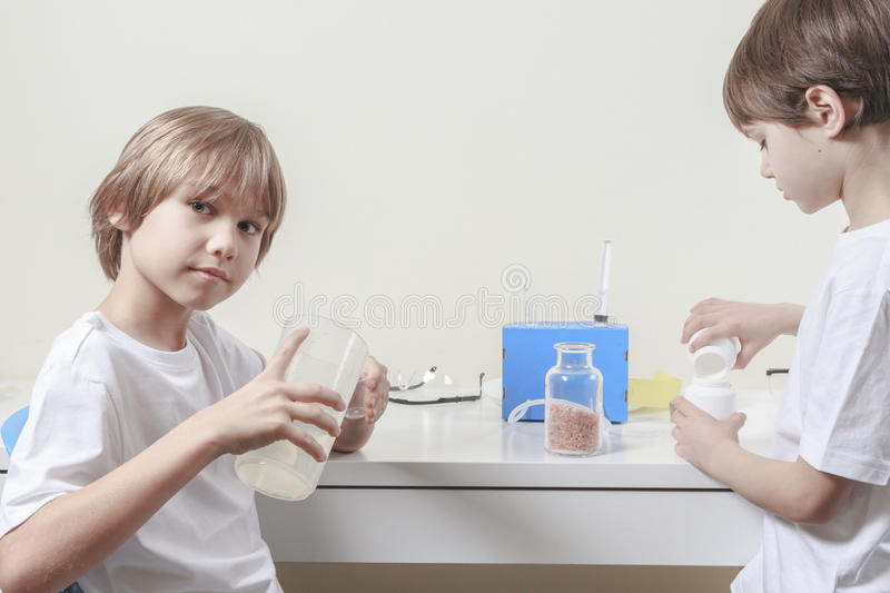 Boys making science experiments. Education concept. Children making science experiments. Education, science concept stock photo