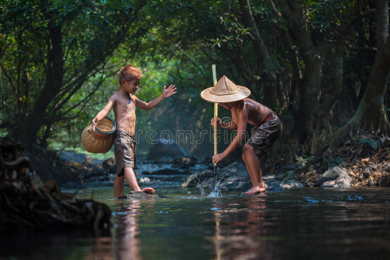 Boys in nature stream. Boys friend Play water and Fishing in nature stream royalty free stock photo