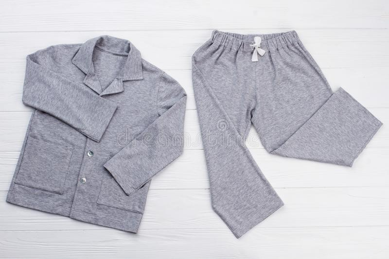 Boys` pajama set on white. Soft gray melange cotton. Loose-fitting shirt and pants for comfort rest at night royalty free stock photos