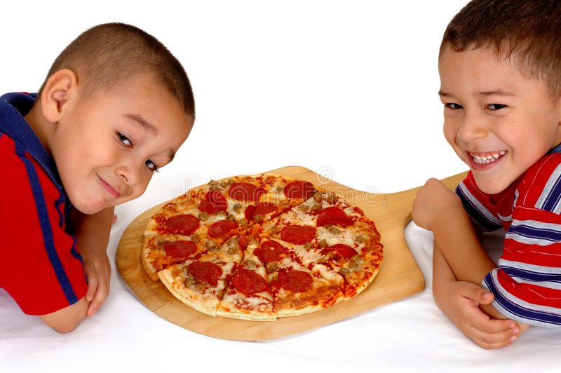 Boys and Pizza. Two young brothers ready to eat a pepperoni pizza royalty free stock photos