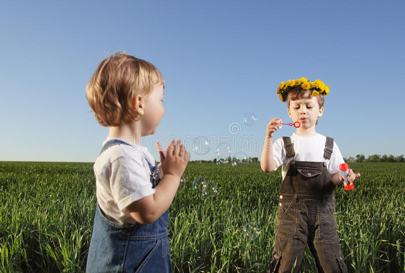 Download Boys Play In Bubbles Royalty Free Stock Image - Image: 31326006