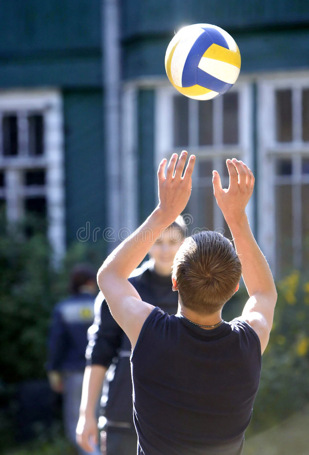Boys play volley ball stock image