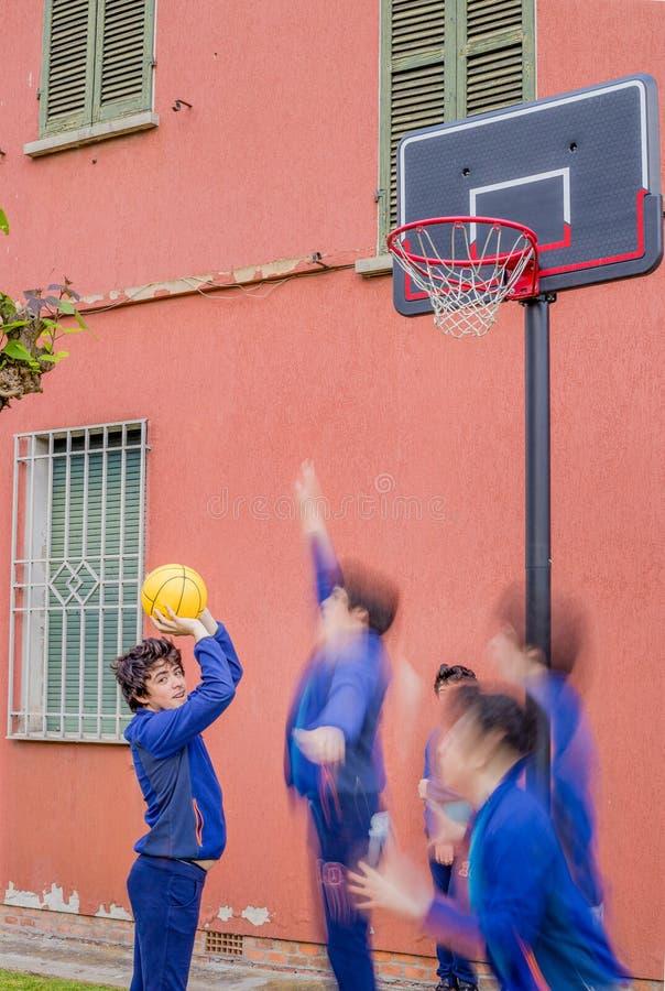 Boys playing basketball stock photos